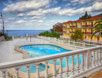 Holiday Luxury Complex. Terrace with swimming pool royalty free stock image