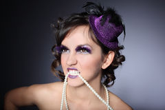 Holiday Make-up.Girl with a purple hat Royalty Free Stock Photography