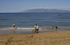 HOLIDAY MAKERS ON BEACH Royalty Free Stock Photo