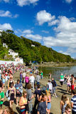 Holiday-makers on the beach, Portmeirion Stock Image