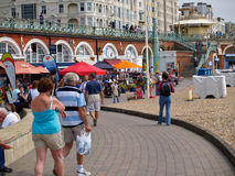 Holiday-makers at Brighton, UK. BRIGHTON, ENGLAND - June 16 - the crowd walks around the walkways along the well know holiday beach on June 16, 2009. Bright Stock Image