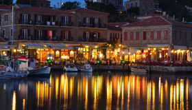 Holiday makers dining in harbor side restaurants Molyvos Greece royalty free stock photo