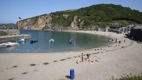 Holiday makers Polkerris beach Cornwall England near St Austell and Par Royalty Free Stock Images
