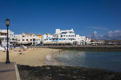 Holiday makers on vacation on the town beach Corralejo Fuerteven Stock Images