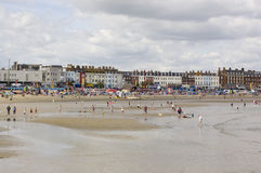 Holiday makers on Weymouth Beach Royalty Free Stock Photography