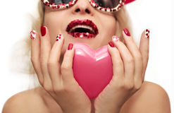Holiday makeup and manicure with red hearts Stock Photo