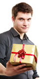 Holiday. Man giving golden gift box with ribbon Royalty Free Stock Photo