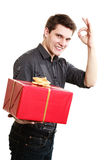 Holiday. Man giving red gift box showing thumb up Royalty Free Stock Photos