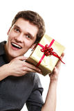 Holiday. Man got golden gift box with red ribbon Royalty Free Stock Images