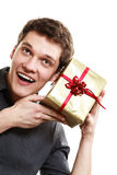 Holiday. Man got golden gift box with red ribbon Stock Photo