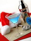 Holiday Martini. Santa taking a break and drinking a martini Stock Image