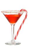 Holiday martini with a candy cane Stock Photos