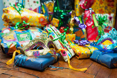 Holiday mask in front of Christmas presents 3. Colourful Christmas presents situated in the back of the Holiday mask Stock Image