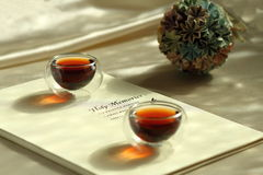 Two cups of Black Tea and holiday album Royalty Free Stock Photo