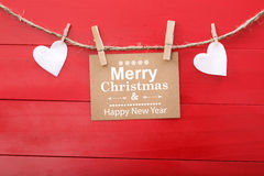 Holiday message with felt hearts and clothespins Stock Images