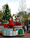 Holiday Mickey and Minnie Mouse on Parade. Mickey and Minnie Mouse lead the Holiday Parade at Disney World Royalty Free Stock Image