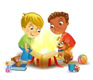 Holiday miracle - boys opening a magic gift Stock Photo