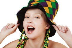 Holiday mood. Pretty blond girl in clown hat making faces Stock Photo