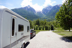 Holiday in the mountains with the caravan Stock Images