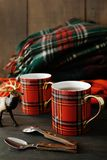 Holiday mugs with hot tea on wood table royalty free stock photo