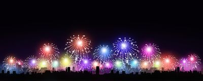 Holiday city Fireworks. Holiday multiclor fireworks in the city at night Royalty Free Stock Image