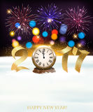 Holiday New Year background with 2017 and colorful fireworks. Royalty Free Stock Images