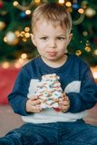 Holiday new year christmas child eats delicious cake. From the table stock photo