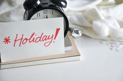 Holiday Note Cover Alarm Clock on White Background Stock Photography