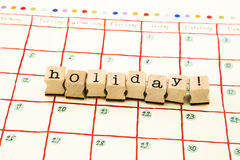 Holiday note date stack on calendar Royalty Free Stock Photos
