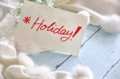 Holiday Note with White Fluffy Scarf Background Royalty Free Stock Photo
