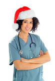 Holiday Nurse. African American Hospital Nurse Wearing Scrubs And a Santa Hat For The Holidays stock photo