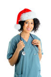 Holiday Nurse. African American Hospital Nurse Wearing Scrubs And a Santa Hat For The Christmas Holidays royalty free stock images