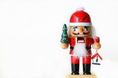 Holiday Nutcracker. Horizontal nutcracker against white background Stock Photo