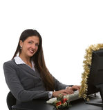Holiday Online Sales. Young woman on computer for doing support for christmas sales Stock Photo