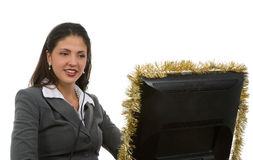 Holiday Online Sales. Young woman on computer for doing support for christmas sales Royalty Free Stock Photos