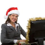Holiday Online Sales. Young woman on computer for doing support for christmas sales Royalty Free Stock Image