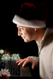 Holiday Online shopping. Man online shopping ,wearings a Santa hat Royalty Free Stock Photography