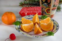 Holiday oranges under the tree. Stock Photos