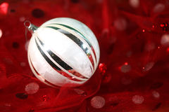 Holiday Ornament on Festive Fabric Royalty Free Stock Photo