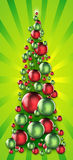Holiday ornament tree on radiant background. New Year's/Holiday/Christmas tree made of red and green reflective ornaments against radiant yellow-green background Royalty Free Stock Photos