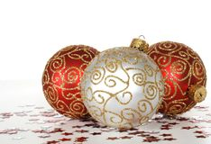 Holiday ornaments. Three colorful holiday ornaments, red and white Royalty Free Stock Photos