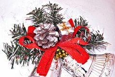 Holiday Ornaments. Christmas ornament made by bells, pineapple and red ribbon on backscatter Stock Images
