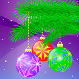 Holiday Ornaments. Beautiful holiday ornaments hanging off Christmas tree branch Royalty Free Stock Images