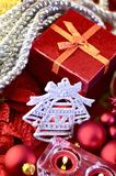 Holiday Ornaments. Red Present Box, Silver Bell Ornament and Some Candles. Holidays Photo Collection Stock Photo