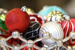 Holiday Ornaments. Brightly colored holiday ornaments ready to decorate the tree royalty free stock photo