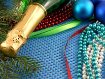 Holiday ornaments, champagne, pearl and balls as a New Year decoration Stock Image