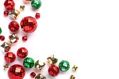 Holiday ornaments and decorations on white, random arrangement. Top view royalty free stock photos