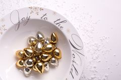 Holiday ornaments in decorative bowl with snow on white background. Top view royalty free stock photos