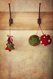 Holiday ornaments hanging on antique wall hooks Stock Photos