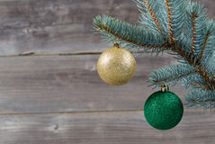 Holiday Ornaments hanging from Blue Spruce Tree Branch Stock Photos